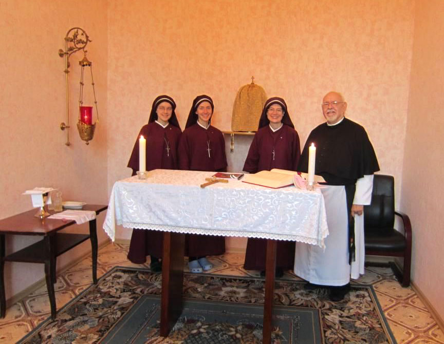 sisters and priest in chapel