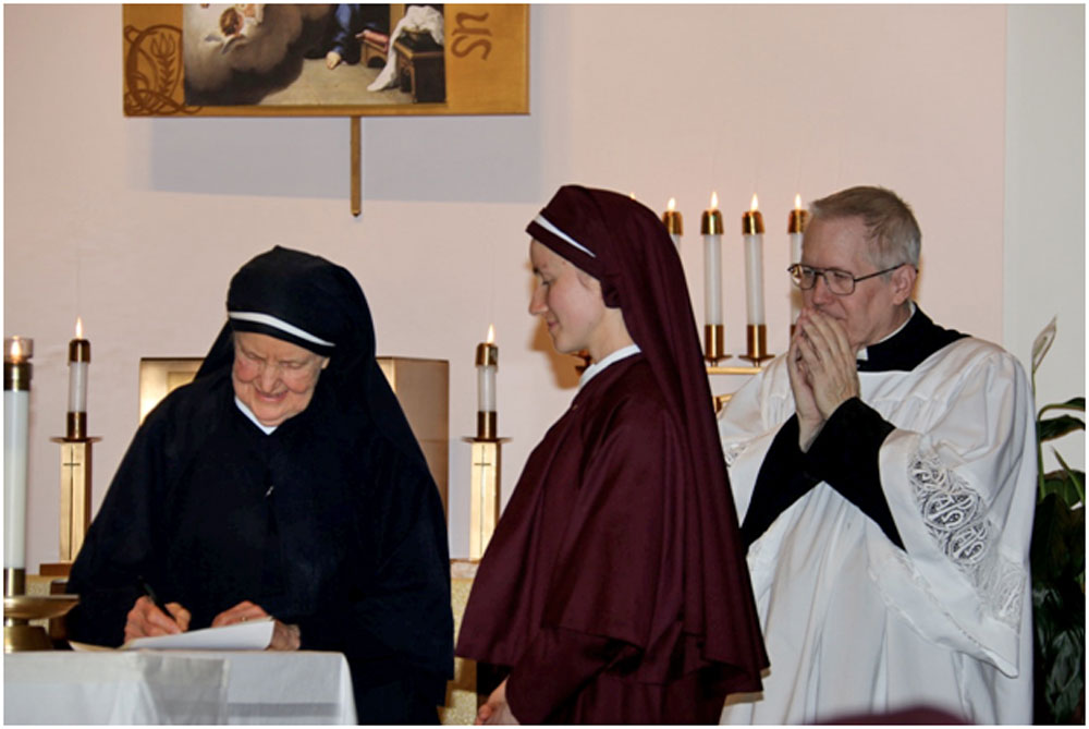 Mother Julia signing Sr. Faustina Marie's vows