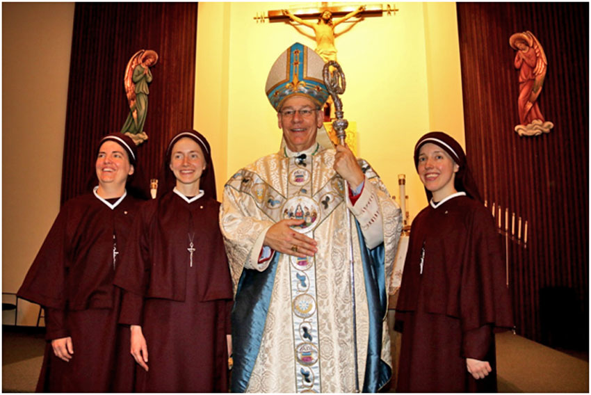 Bishop Finn with the newly-vowed sisters after Mass.
