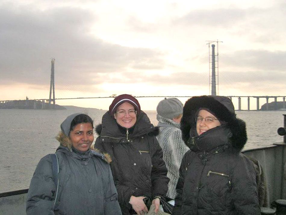 Sisters and friend near bridge in Vladivostok