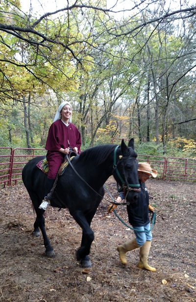 Sister Gemma Maria riding with dear friend Sylvia leading her horse