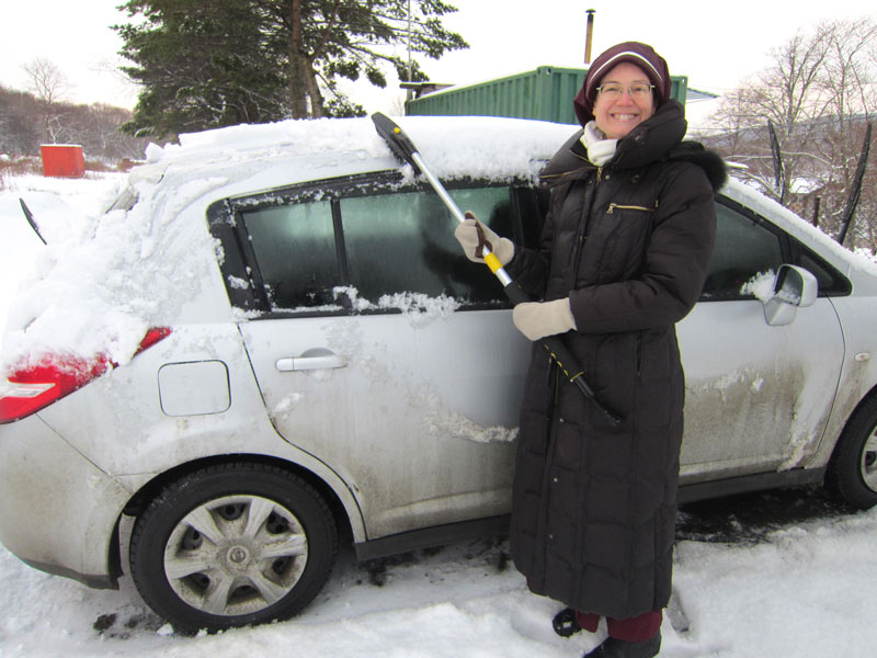 Sister Maria Stella cleaning snow off the car before a trip to Mass in Vladivostok
