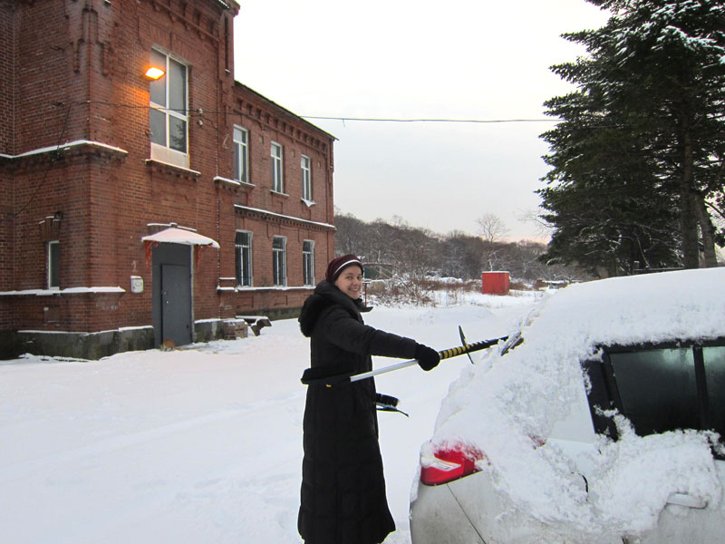 Sister Catherine Marie cleaning the snow from her car