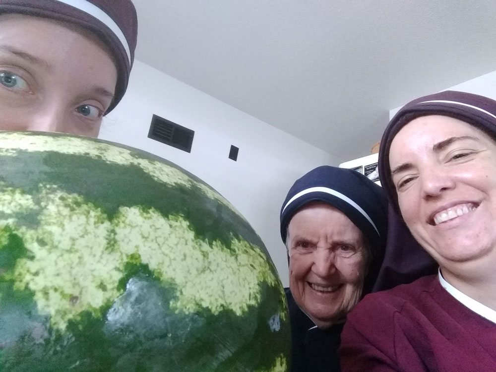 The sisters with a very large watermelon