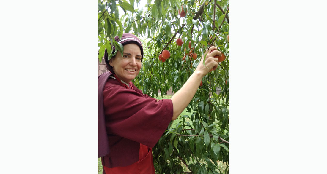 sister Maria Damiana picking peaches